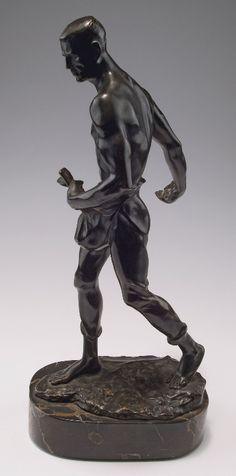 Bruno Zach. Walking man, c1930. H. 38.2 cm (incl. base). Bronze, black patina, black/brown marble base. Plinth marked: Bruno Zach.