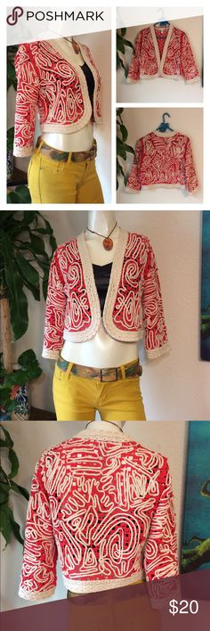 """Chicos Soutache Knit Bolero Shrug Crochet Jacket This is a fun to wear knit shrug from Chico's.  The color is more orange than red and looks great with Navy.  It is a bolero style in a size 0. Or chico's sizing would fit a small to medium.   Gorgeous ivory braided trim and fantastic embroidered soutache design throughout!  No flaws to note - very gently used. Approx measurements laid flat- (double where necessary)  Shoulder to shoulder: 14.5"""" Underarm to underarm: 19"""" Waist: 18"""" Shoulder…"""