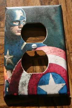 Captain America outlet cover plate. (mod podge and clear coat?)  --Not sure how expensive this would be but it could be pretty fun. We could also get covers that the kids could color in themselves... - Visit to grab an amazing super hero shirt now on sale!