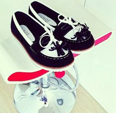 Black and white tassel loafers by V.N.D.S
