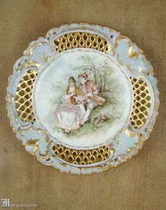 Antique cabinet plate, reticulated, gilded, hand-decorated porcelain, romantic rococo lovers scene with ornate pierced gilt rim.