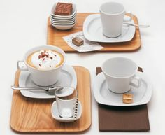 The aroma of coffee unfolds perfectly in the conically fluted form of these cups with a distinctive handle design