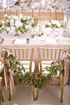 Gorgeous table and bride and groom chairs (Erin Fetherston's wedding reception)