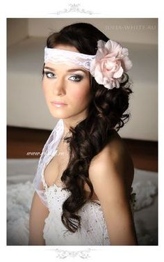 1920's inspired wedding hairstyles with overhead strands to create large curls with natural strands of hair