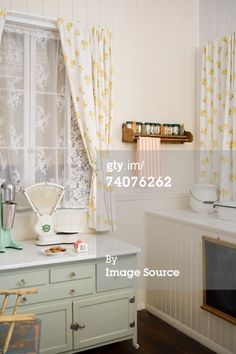 Liven up your space with cafe curtains! Learn how to select, style and hang cafe curtains in your home. Home Curtains, Hanging Curtains, Kitchen Curtains, Shabby Chic Kitchen, Home Decor Kitchen, Kitchen Ideas, Home Construction Cost, Curtain Styles, Curtain Ideas
