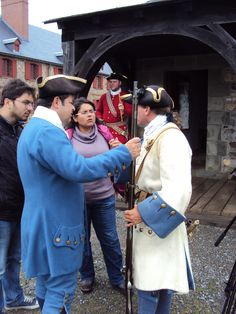 Chef Vicky Ratnani and his film crew learning about the 18th century musket at the Fortress of Louisbourg National Historic Site