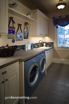 Love all the counter space..I WANT THIS LAUNDRY ROOM!!!!!!