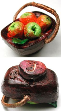 """Hand-carved ceramic studio button.  Realistic basket of apples design with movable copper trimmed leather handle, making it a mechanical . Hand made by Candice Hardin.  1"""".  Sold eBay 01/2018 by so-cal-button-gal.  $178.49"""