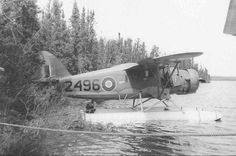 Bill Carr's Norseman 2496 is seen tied to the shore at a site known simply at Pt. 3. Carr's Norseman was painted in standard RCAF camouflage and Type C-1 Roundels. Photo: Bill McRae Collection