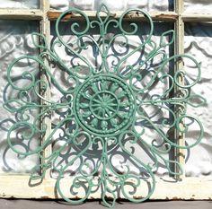 Wrought Iron Wall Decor/ Metal Wall Hanging/ Indoor/ Outdoor Metal Wall Art/ Patio/ Cottage/ Garden Decor. $31.50, via Etsy.