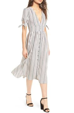 Playful knots grace the sleeves of this breezily striped midi dress styled with a plunging neckline and vintage-inspired button closure.