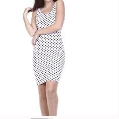 Tea and Cup Sexy Polka Dot Dress M/L This gorgeous dress is perfect for any occasion.  Wear with a cardi or blazer now or wear solo during the warmer month.  The open back with chain detail is super sexy.  Strut your stuff with your favorite couture pumps!  100% Polyester. Tea n Cup Dresses Mini