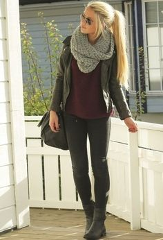 Black jacket, burgundy shirt, black leggings and boots