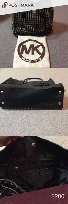 Michael Kors black and gold grommet hamilton Lightly used black and gold grommet special edition Hamilton. No grommets missing. The feet are lightly scratched (hence the lightly used description). It is such a beautiful bag! Comes with original dust bag Michael Kors Bags Shoulder Bags