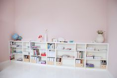 This photo stream of her house is great.  these are billy bookcases with an MDF top across.