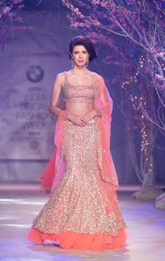 Beautiful Indian bridal peach mermaid style lehnga with tulle border by Jyotsna Tiwari. More here: http://www.indianweddingsite.com/bmw-india-bridal-fashion-week-ibfw-2014-jyotsna-tiwari/