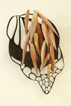 Leia Zumbro    Copper, wood. Wonderfully sculptural