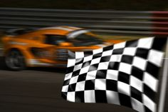 bigstock-Orange-Racing-Car-And-Chequere-2484520