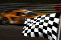 bigstock-Orange-Racing-Car-And-Chequere-2484520