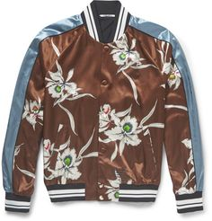 This Valentino bomber is cut from lustrous satin and printed with oriental orchids. The ribbed-knit trims and striped sleeves add a touch of classic collegiate cool to the statement design.