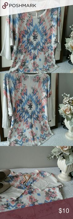 "Beautiful casual top! Soft roomy top. Can be worn with spandex,  jeans or slacks. Medium that can be worn as large also. A tiny snug in the middle not noticeably. Cream, blue, peach , pink multi colors, arm pit to arm pit 22 1/2"" Charlotte Russe Tops Blouses"