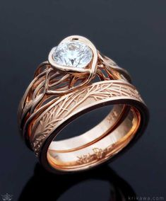 Embracing Tree Branch Bezel Engagement Ring and Tree of Life Wedding Band in 14k rose gold with a white diamond solitaire. This set is made to order in the metal and stones you want! Design your nature-inspired bridal set at krikawa.com
