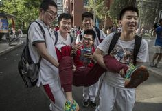 Chinese students celebrating with one another after completing the gaokao at Beijing Renmin University Affiliated High School on June 8.