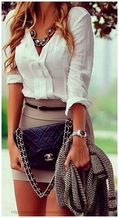 White blouse with tan mini skirt and statement necklace | Great Fashion & Style Inspiration #fashion #fashions http://www.opulencetraining.com/