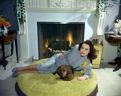 {Joan Crawford + doxie} love that giant pouf they're on!