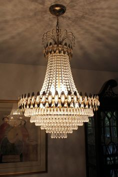 PORTABLE FIXTURES: CEILING - CHANDELIER. I think that this chandelier could be considered general lighting, because it lights up the whole room.