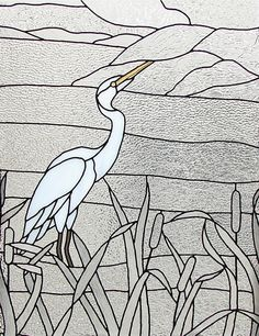 Stained glass window featuring a Snowy Egret.
