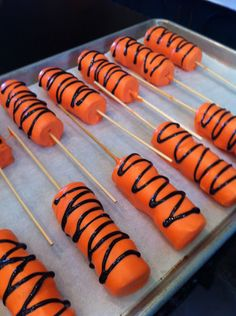 ~ marshmallows on a stick dipped in orange chocolate coating ~ no need for brown stripes ~ would change the decoration to fit the theme better ~