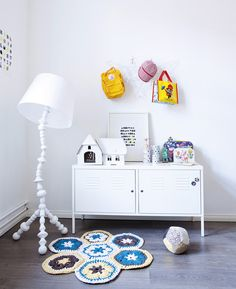 Not a fan of the rug, but nice visual of how a nicer one could add texture to a kids room (rugs, blankets, stuffies, pillows)