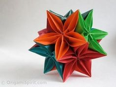 Origami tutorial and video instruction on how to make a kusudama using a pentagonal flower called carambola created by Carmen Sprung (Germany). A demonstrati...