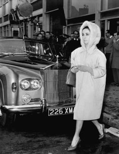 Elizabeth Taylor leaves the set of The VIPs at London Airport on March 20, 1963. Taylor was following in the wake of her costar, Richard Burton, who had stormed off the set complaining about the crowd of onlookers milling about.