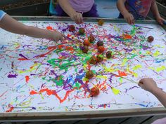 Ping Pong Art! Similar to marble painting (but using ping pong balls and straws), the children can create a lovely painting... I especially love the idea of this as a large-scale project!