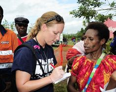 A volunteer takes down a woman's information.