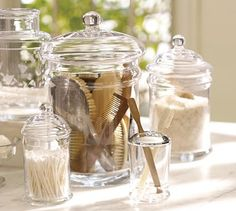 Bathroom- i did somthng similar & cheaper- cute sugar bowl for cotton balls/great glass small canister jar qtips-in kitchen area-looks snazzzy w/ nice candle accent