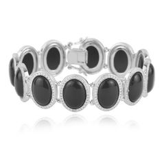 """Sterling Silver 14x10mm Oval Black Agate and Diamond Accent Bracelet, 7.25"""" Amazon Curated Collection. Save 75 Off!. $129.00. Gemstones may have been treated to improve their appearance or durability and may require special care.. Made in China. The natural properties and composition of mined gemstones define the unique beauty of each piece. The image may show slight differences to the actual stone in color and texture."""