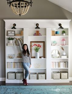 Want to know how to build your own library wall? I started with 3 ikea billy bookcases and modified them to look custom! Read on as I share all the details!