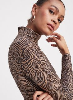 Complete the look in must-have tops at Miss Selfridge. From cute cropped bralets to essential tees, we've a top to suit you. Collect free in store. Roll Neck Top, Zebra Print, Miss Selfridge, Latest Trends, Long Sleeve, Model, Zebra Crossing, Fashion Trends, Clothes
