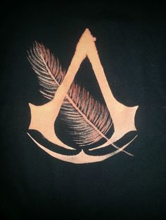 One of Petruccio's feathers with the AC symbol. Posted on imgur.com.