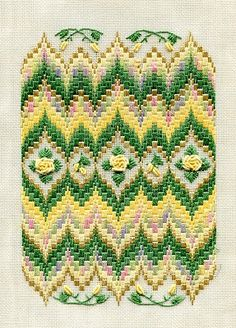Two-Handed Stitcher, Laura Perin bargello needlepoint. I love the little flowers at the top and bottom of this design :)