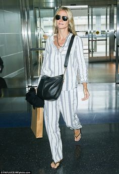 Pajama envy: Heidi Klum looked very comfortable and ready for her flight as she arrived at JFK Airport in NYC on Thursday
