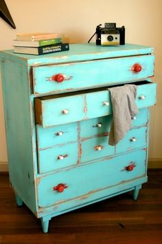 Shabby Chic Distressed Vintage Dresser. love the red handles with the aqua color. by bessie