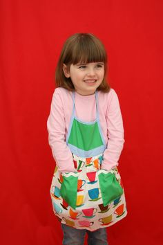 100% cotton fun and fashionable apron-frocks. Comes in a variety of inter-mixed fabrics with two pockets and exclusive of trim.