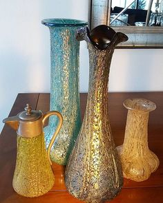Pallme König four different iridescent glass vases covered in frit and trailings of the same color. Circa 1900 www.madforglass.com #pallmekonig #bohemianglass #antiqueglass #artnouveauglass #cristalantiguo #vidreantic