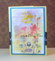 White emboss text, paint over with distress inks, water stamp flowers