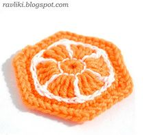 Orange motif. Pattern is for slippers, but could make it into a lapghan/afghan!