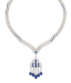 The Art Deco-style sautoir suspending articulated fringes set with five sugarloaf cabochon sapphires, accented throughout with faceted sapphires, further set with round and single-cut diamonds weighing approximately 7.75 carats, the pendant with four cultured pearls, the necklace spaced by openwork segments decorated with seed pearls